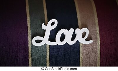 White wooden word love on colourful background