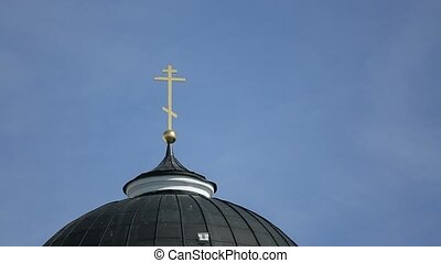 Cross on dome of the cathedral at sunny day