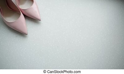 Pink woman's shoes on white background