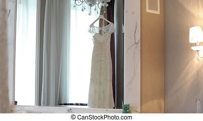 Wedding dress in room shot
