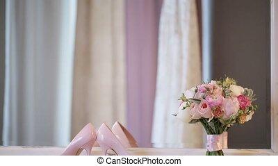 Woman's shoes and bridal bouquet closeup