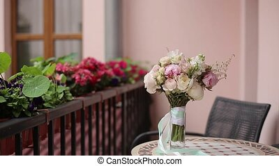 Bouquet on table at balcony