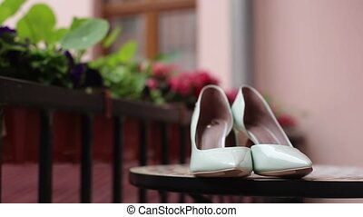 Light green woman's shoes on balcony