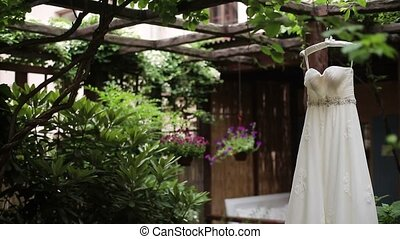 Wedding dress in garden at cloudy day