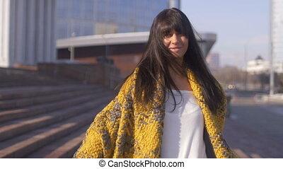 Brunette female smiling on city background - Brunette female...