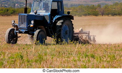 Tractor at high speed plowed field.