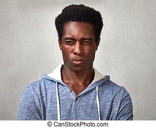 Man looking camera. - Close-up of man face incomprehension...