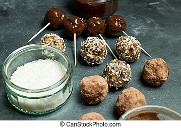 Various Protein Energy Balls and Dessicated Coconut in Bowl...