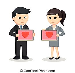 business couple with love icon in their tablet