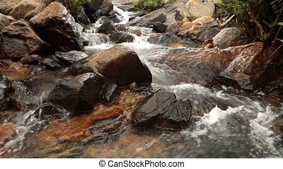 Mountain Stream - A mountain waterfall scene with large...