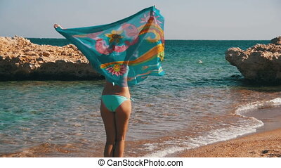 Happy Woman with Scarf Walking on the Summer Beach in Slow...