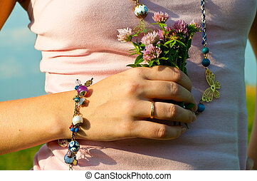 Hand with bunch of flowers - The picture of the womans hand...