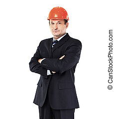 Experienced engineer, the architect, stands with his hands folde