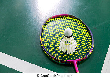 bad condition badminton ball with badminton racquet after...