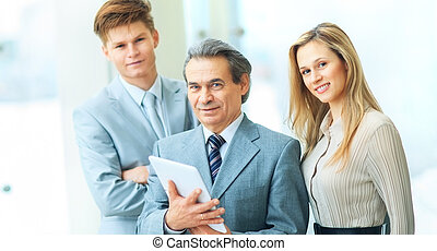 boss with digital tablet and his business team - Boss and...