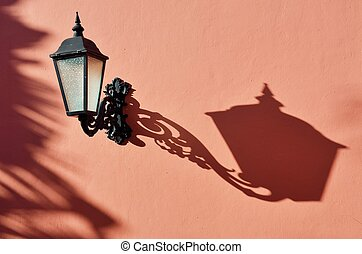 Antique lamp with shadow with pink wall