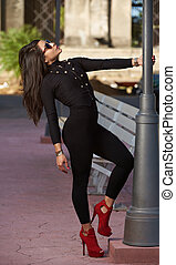 Glamur young girl posing in street in black casual cloth and...