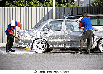 Car Wash - Image of commercial car washers in action.