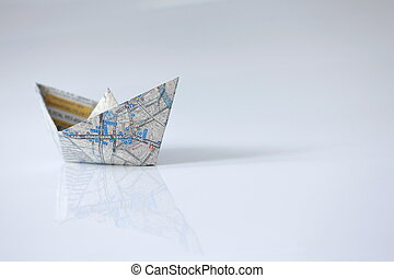 Paper ship from the map on a white