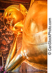 Head of the Reclining Buddha in a temple in Bangkok,...