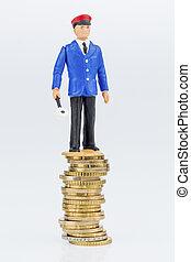 railway worker stands on money stack - railway worker on...