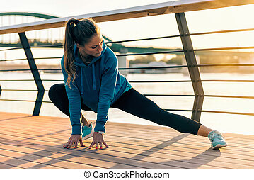 Female athlete streching outdoors