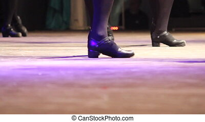Women stepping Irish dance with traditional shoes at celtic...