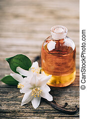 Essential oil with jasmine flower and vanilla. Aromatherapy...