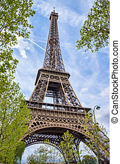 Eiffel tower with blue sky in the background.