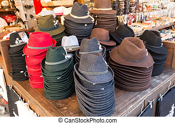 Traditional austrian hats for sale in a outdoor souvenir shop in the center of Salzburg.