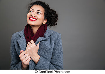 Young african american woman wearing winter coat