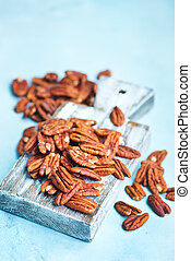 pecan nuts on board and on a table