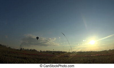 Balloons flying over the field on clear brigth day - Several...