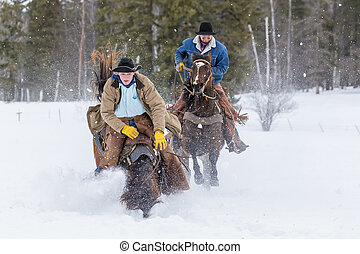 Cowboys Herding Horses In The Snow