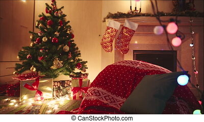 Decorated room on christmas night. Fireplace with christmas...