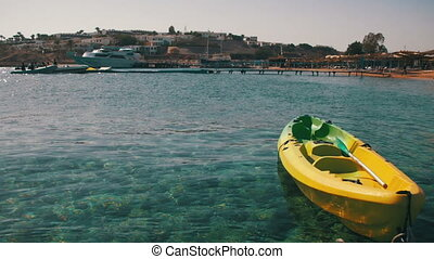Boat Tied to a Pier in the Red Sea on the Beach Background -...