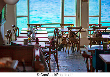 Summer empty openair cafe with beautiful view to the sea in...