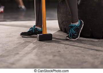 black woman after workout with hammer with focus on legs