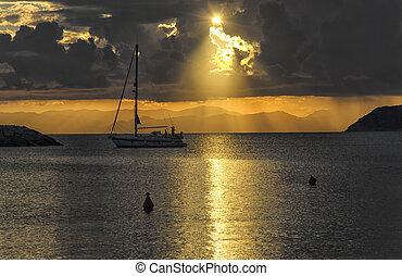 Sailing boat at the sunset - View of sailing boat at the...