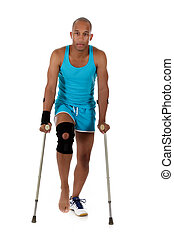 Young attractive African American man athlete, crutches -...