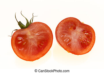 Ripe tomatoes cut into two halves on white background