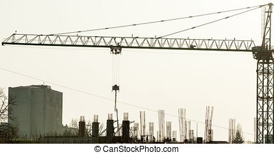 4K time lapse of silhouette of men working on construction...