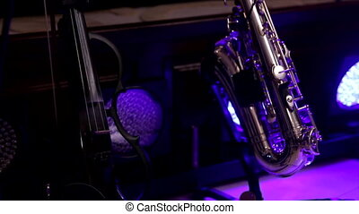 Close up of musical instruments - clarinet, violin, saxophone on against the backdrop of light music