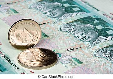 Malaysian Currency - Image of Malaysian notes and coins. The...