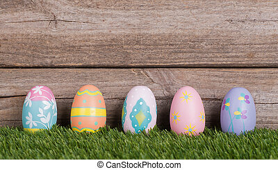 Colorful Easter Eggs on Grass - Colorful Easter eggs on...