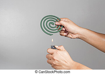 The gesture was a mosquito coil. To prevent mosquito in the...