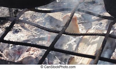 fry bread on fire. Real flames in the fire with burning logs