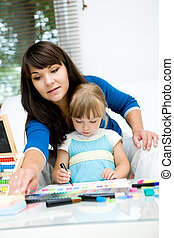 kindergarden - mother and daughter having fun in...