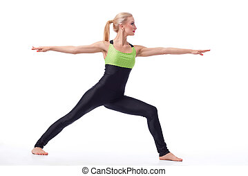Attractive female gymnast exercising at studio - Calm and...