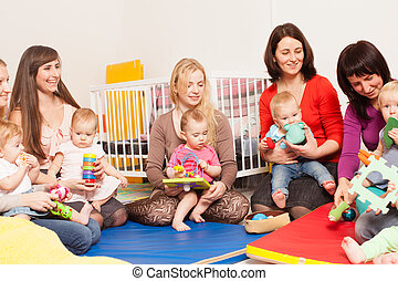 Group of mothers with their babies - Four moms with their...